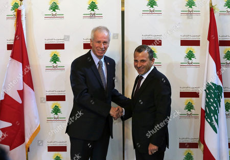 Gibran Bassil, Stephane Dion Lebanese foreign minister Gibran Bassil, right, shakes hands with his Canadian counterpart Stephane Dion, right, at the Lebanese foreign ministry, in Beirut, Lebanon, . Dion is in Beirut to meet with Lebanese officials