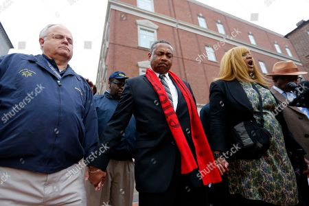 Stock Image of Rob Dewey, Thomas Dixon Rob Dewey, left, with the Coastal Crisis Chaplaincy and pastor Thomas Dixon, second from left, participate in a prayer vigil in front of the Charleston County Courthouse as the jury deliberates in the Michael Slager trial, in Charleston, S.C. Slager, the former North Charleston police officer is charged with murder in the shooting death last year of Walter Scott