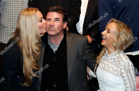 Lindsey Vonn, Kevin Plank, Nastia Liukin Olympic athlete Lindsey Vonn, left, gives a kiss to Under Armour Chief Executive Officer and founder Kevin Plank, with Nastia Liukin, as they pose for photographers during an announcement event at Major League Baseball's winter meetings, in Oxon Hill, Md. Under Armour will take over as the supplier of Major League Baseball uniforms in 2020