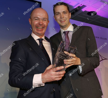 Luke Harvey presenting Patrick McCann with Racing Photograph of the Year The Derby Awards