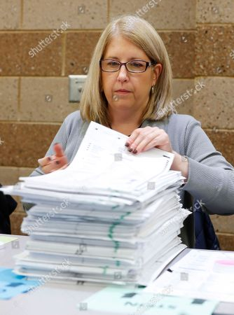 Cari Newbeck, deputy clerk, Oakland Township, counts ballots during a statewide presidential election recount in Waterford Township, Mich., . The recount comes at the request of Green Party candidate Jill Stein, who also requested recounts in Pennsylvania and Wisconsin