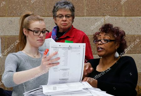Officials count ballots during a statewide presidential election recount in Waterford Township, Mich., . The recount comes at the request of Green Party candidate Jill Stein, who also requested recounts in Pennsylvania and Wisconsin