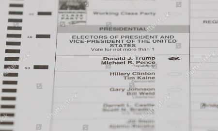 A ballot with a vote for Donald J. Trump is shown during a statewide presidential election recount in Waterford Township, Mich., . The recount comes at the request of Green Party candidate Jill Stein, who also requested recounts in Pennsylvania and Wisconsin