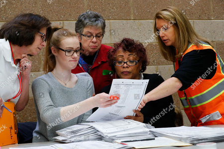 A challenge is reviewed on a ballot during a statewide presidential election recount in Waterford Township, Mich., . The recount comes at the request of Green Party candidate Jill Stein who also requested recounts in Pennsylvania and Wisconsin