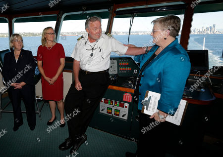 Lynne Griffith, Stephen Hopkins In this Oct. 6, 2014 photo, Lynne Griffith, right, assistant secretary for the Department of Transportation's ferries division, talks with ferry Captain Stephen Hopkins, second from right, as U.S. Sen. Patty Murray, D-Wash., left, and Lynn Peterson, second from left, Washington state Secretary of Transportation, look on as they ride a Washington state ferry traveling between Seattle and Bainbridge Island, Wash. The Washington Dept. of Transportation announced, that Griffith, who heads the ferries division, will be retiring in January, 2017