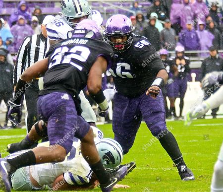 TCU lineman Chris Bradley (56) helps to shut down runner during NCAA football game between Kansas State Wildcats and TCU Horned Frogs at Amon G. Carter Stadium in Forth Worth Texas. Kansas State defeated TCU 30-6