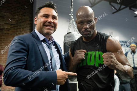 Bernard Hopkins, right, and Oscar De La Hoya pose for photographs during a media workout in Philadelphia, . Hopkins is scheduled to fight Joe Smith Jr., in a light heavyweight boxing match on Dec. 17 at the Forum, in Inglewood, Calif