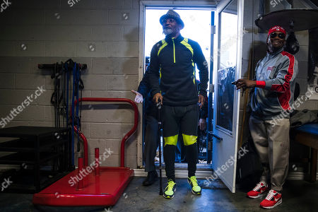 Bernard Hopkins arrives in a fake beard and carrying a cane as part of a joke for media workout in Philadelphia, . Hopkins is scheduled to fight Joe Smith Jr., in a light heavyweight boxing match on Dec. 17 at the Forum, in Inglewood, Calif