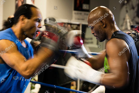 Bernard Hopkins, right, trains with John David Jackson during a media workout in Philadelphia, . Hopkins is scheduled to fight Joe Smith Jr., in a light heavyweight boxing match on Dec. 17 at the Forum, in Inglewood, Calif