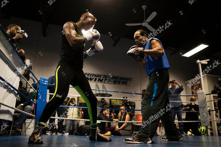 Bernard Hopkins, left, trains with John David Jackson during a media workout in Philadelphia, . Hopkins is scheduled to fight Joe Smith Jr., in a light heavyweight boxing match on Dec. 17 at the Forum, in Inglewood, Calif