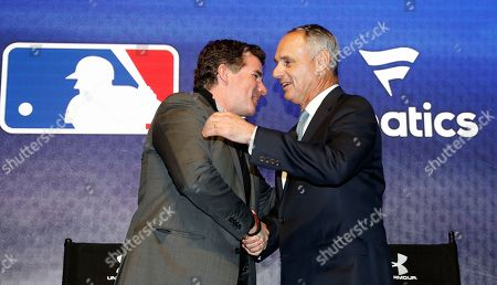 Kevin Plank, Rob Manfred Under Armour Chief Executive Officer and founder Kevin Plank, left, shakes hands with Major League Baseball commissioner Rob Manfred after an Under Armour announcement event at Major League Baseball's winter meetings, in Oxon Hill, Md. Under Armour will take over as the supplier of Major League Baseball uniforms in 2020