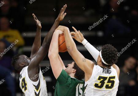 Peter Jok, Cordell Pemsl, Clay Verk Iowa guard Peter Jok, left, and forward Cordell Pemsl, right, block a shot by Stetson forward Clay Verk (15) during the first half of an NCAA college basketball game, in Iowa City, Iowa