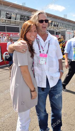 Stock Photo of Formula 1 Santander British Grand Prix at Silverstone - Race Day Eric Clapton with His Wife Melia Mcenery