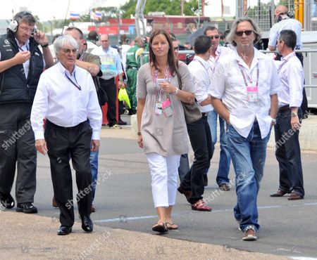Formula 1 Santander British Grand Prix at Silverstone - Race Day Bernie Ecclestone Walking with Eric Clapton and His Wife Melia Mcenery