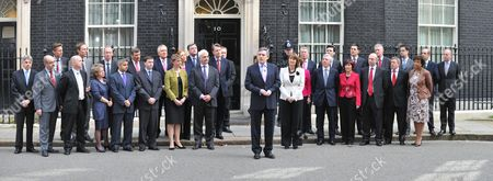 Stock Image of Announcement of the Date of the General Election in Downing Street Lord Drayson Jim Knight Ben Bradshaw Liam Byrne Jim Murphy Rosie Winterton Sadiq Khan Bob Ainsworth Douglas Alexander Peter Hain Yvette Cooper Baroness Royall Ed Balls Nick Brown Lord Peter Mandelson Pm Gordon Brown Tessa Jowell Alan Johnson Andy Burnham Jack Straw Dawn Primarolo David Miliband John Healy Hilary Benn Mp Ed Miliband John Denham Lord Adonis Countess Scotland and Shaun WoodwardThis is A Join Up From 5 Images Taken Side by Side
