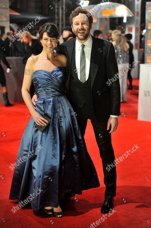 Bafta Film Awards Outside Arrivals at the Royal Opera House Covent Garden Chris O'dowd with His Girlfriend Dawn Porter