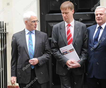 Alistair Darling U K Chancellor of the Exchequer Holds the Gladstone Dispatch Box Containing the 2010 Budget Outside 11 Downing Street in London with Stephen Timms Mp (l) and Lord Paul Myners