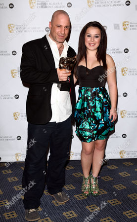 Stock Image of Ea British Academy Children's Awards at the Hilton Park Lane - Press Room Dani Harmer Presents Best Learning - Secondary to 'Troubles Minds' to Andy Glynne