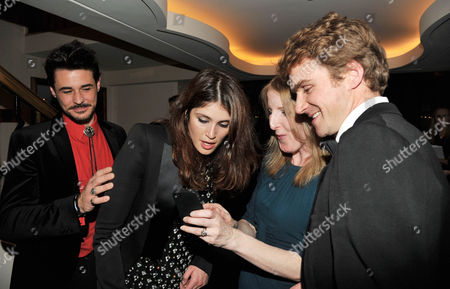 Evening Standard Drama Awards at the Savoy Hotel Fenella Woolgar with Her Husband Dr Robert Harland Show Pictures On Their Phone of Their Children to Gemma Arterton and Her Husband Stefano Catelli