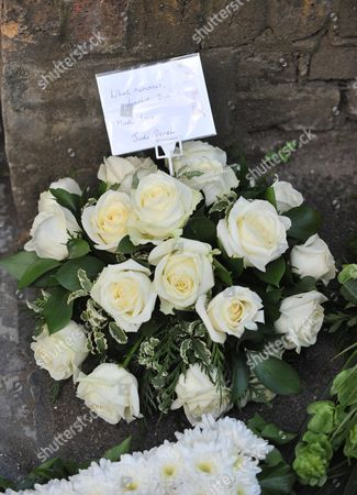 Funeral of Danny La Rue at the Church of the Transfiguration Chamberlayne Road Kensal Rise London Flowres From Judi Dench