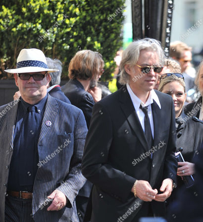 Funeral at Number 1 Marylebone Road and Procession in Camden Town Paul Mcguinness and Sir Bob Geldof