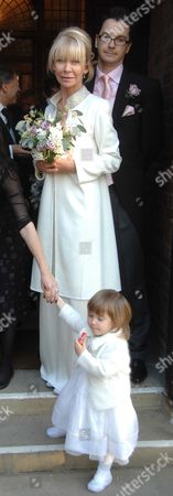 Stock Picture of Wedding of Michael Holland & Denise O'donoghue at Chelsea Old Church Old Church Street Chelsea London Denise O'donoghue with Bridesmaid Molly Mulville ( Daughter of Jimmy Mulville Denise's 1st Husband )