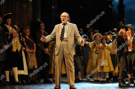 Stock Photo of Oliver 50th Anniversary of the First Stage Performance at New Theatre (now the Noel Coward Theatre) On June 30 1960 Now at the Theatre Royal Drury Lane London the First Fagin Ron Moody Makes A Speech Nad Performs A Song with the Cast Including Russ Abbot (the Current Fagin) and the Company and Jack Costello As Nipper