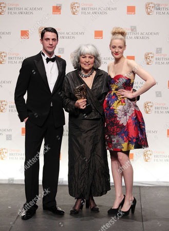 Stock Image of Orange 2010 British Academy Film Awards Press Room at the Royal Opera House Covent Garden Matthew Goode and Ramola Garai Present Best Hair and Makeup with the Winner Jenny Shircore (the Young Victoria)