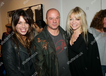 Private View For 'Russell Young: Dirty Pretty Things' at Scream Gallery Burton Street Mayfair Willa Keswick with the Artist Russell Young and Jo Wood