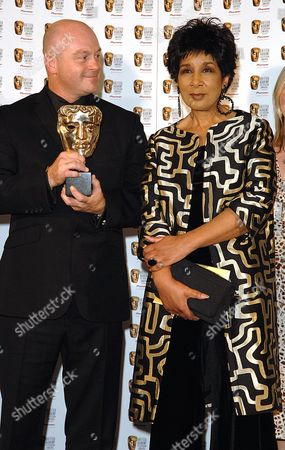 Stock Photo of 2007 Bafta Television Awards Press Room at the London Palladium Best Factual Series - Ross Kemp On Gangs Ross Kemp with His Award and the Presenter of the Award Moira Stewart