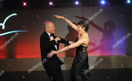 Stock Photo of the Olivier Theatre Awards Arrivals and Drinks Reception at the Grosvenor House Hotel Tamsin Greig Congratulates Winner of the Best Entertainment Award Tim Whitnall For ''morecambe'