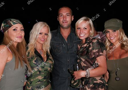 Stock Photo of Uk Premiere Afterparty For 'Tropic of Thunder' at the Icon Bar Empire Casino Leicester Square Calum Best Poses with Glamour Girls - Kayleigh Pearson Malene Espensen Natalie Pike and Rachael Tennent