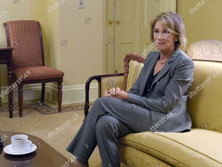 Stock Image of Betsey DeVos Betsy DeVos, President-elect Donald Trump's nominee for Education Secretary, sits with Senate Majority Leader Mitch McConnell of Ky., before the start of their meeting on Capitol Hill in Washington