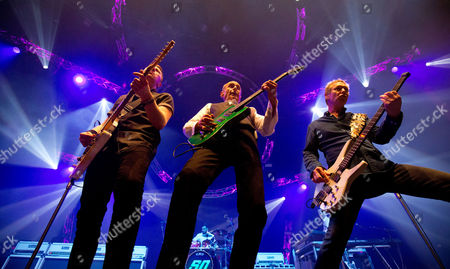 Francis Rossi, John Rhino Edwards (R) and Richie Malone (L) Status Quo Live - Last of the Electrics Tour