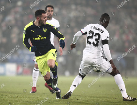 Lucas Perez of Arsenal and Eder Alvarez Balanta of Basel during the UEFA Champions League Group A match between Basel and Arsenal played at St.Jakob-Park, Basel 6th December 2016