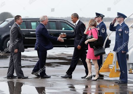 Barack Obama, Kathy Castor President Barack Obama and Rep. Kathy Castor, D-Fla., are greeted by Tampa, Fla. Mayor Bob Buckhorn, center, and St. Petersburg, Fla. Mayor Rick Kriseman as they arrive on Air Force One at Tampa International Airport in Tampa, Fla., en route to MacDill Air Force Base to meet with service members, and uniformed members of the U.S. Special Operations Command and U.S. Central Command. The president is also schedule to speak about the administration's approach to counterterrorism campaign