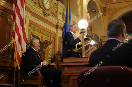 South Dakota Gov. Dennis Daugaard makes his annual budget address to state lawmakers in Pierre, S.D., . Daugaard's budget plan is restrained by lower-than-expected tax collections
