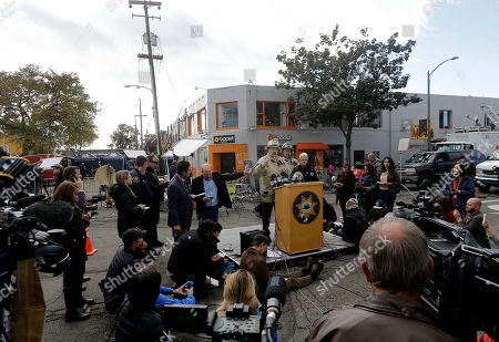 Stock Picture of Oakland Fire Department Operations Chief Mark Hoffman, center, speaks at a news conference near the site of a warehouse fire in Oakland, Calif., . The fire erupted Friday, Dec. 2, killing dozens