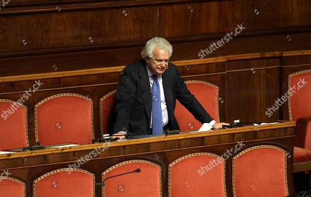 Senator Denis Verdini before voting during a confidence vote on the 2017 budget law in the Italian Senate, in Rome, . Italian President Sergio Mattarella told Italian premier Matteo Renzi, who decided to resign after a humiliating defeat in a referendum on government-championed reforms, to stay in office a bit longer until the critical budget law is passed