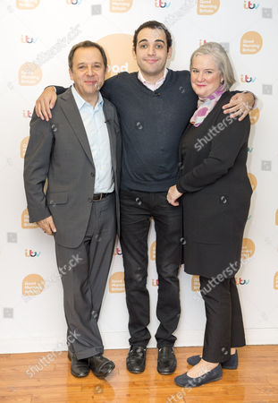 Owen Suskind with parents Ron and Cornelia