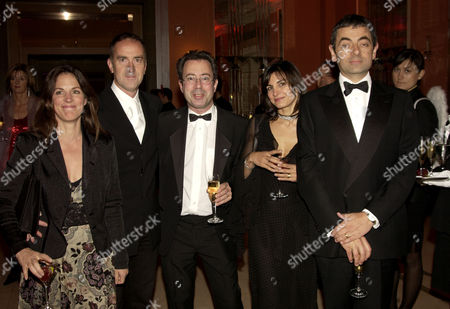 After Party For the Royal European Premiere of 'Bright Young Things' at Claridges London (l-r) Angus Deaton with His Girlfriend Lisa Mayer Ben Elton Rowan Atkinson with His Wife Sunetra Sastry