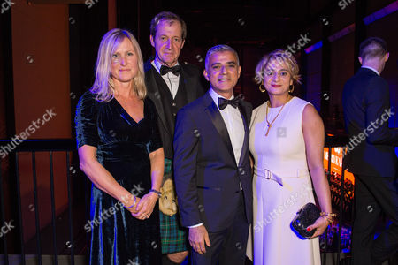 London, England 6th September 2016: Alastair Campbell with Wife Fiona Millar and Sadiq Khan with Wife Saadiya Khan at the Gq Men of the Year Awards in Association with Hugo Boss Held at the Tate Modern On the Southbank in London On the 6th September 2016.