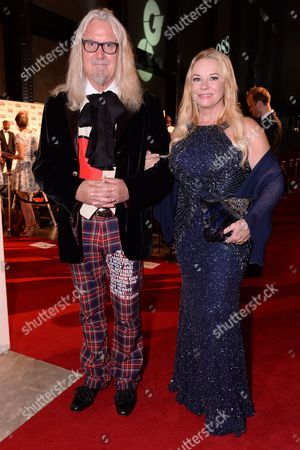 London, England 6th September 2016: Billy Connolly and Pamela Stephenson at the Gq Men of the Year Awards in Association with Hugo Boss Held at the Tate Modern On the Southbank in London On the 6th September 2016.