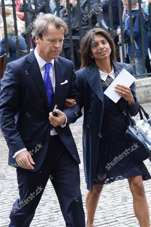 Stock Image of London UK 27th Sept 2016: Joel Cadbury with His Wife Divia Lalvani at the Memorial Service for Terry Wogan at Westminster Abbey, London. September 27, 2016 London UK