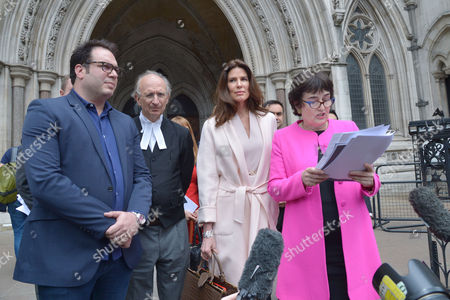 London, England, 8th July 2016 : Christina Estrada Leaves the Royal Courts of Justice with Her Lawyer Frances Hughes After Being Awarded Her Divorce Settlement of £75 Million Pounds From International Business Man Sheikh Walid Juffali After He Allegedly Took Both a Second Wife and Divorced Her Without Her Acknowledgement. This is the Largest Divorce Settlement in English Legal History. London, England On the 8th July 2016..