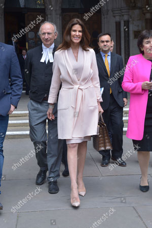 Stock Image of London, England, 8th July 2016 : Christina Estrada Leaves the Royal Courts of Justice with Her Lawyer Frances Hughes After Being Awarded Her Divorce Settlement of £75 Million Pounds From International Business Man Sheikh Walid Juffali After He Allegedly Took Both a Second Wife and Divorced Her Without Her Acknowledgement. This is the Largest Divorce Settlement in English Legal History. London, England On the 8th July 2016..