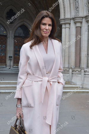 Stock Picture of London, England, 8th July 2016 : Christina Estrada Leaves the Royal Courts of Justice with Her Lawyer Frances Hughes After Being Awarded Her Divorce Settlement of £75 Million Pounds From International Business Man Sheikh Walid Juffali After He Allegedly Took Both a Second Wife and Divorced Her Without Her Acknowledgement. This is the Largest Divorce Settlement in English Legal History. London, England On the 8th July 2016..