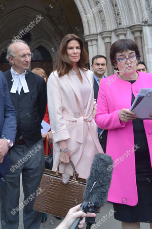 Stock Photo of London, England, 8th July 2016 : Christina Estrada Leaves the Royal Courts of Justice with Her Lawyer Frances Hughes After Being Awarded Her Divorce Settlement of £75 Million Pounds From International Business Man Sheikh Walid Juffali After He Allegedly Took Both a Second Wife and Divorced Her Without Her Acknowledgement. This is the Largest Divorce Settlement in English Legal History. London, England On the 8th July 2016..