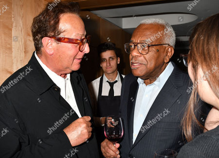 London, England 27th June 2016: Sir Trevor Mcdonald & Lord Maurice Saatchi at the Josephine Hart Poetry Hour at the British Library Euston Road London. 27th June 2016