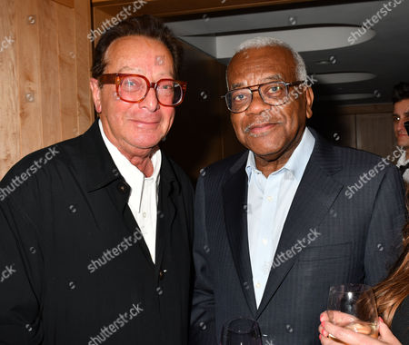 Stock Image of London, England 27th June 2016: Sir Trevor Mcdonald & Lord Maurice Saatchi at the Josephine Hart Poetry Hour at the British Library Euston Road London. 27th June 2016
